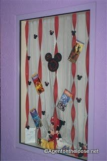 Char's window came up!!    Agent on the Loose: Window Decorating at Walt Disney World