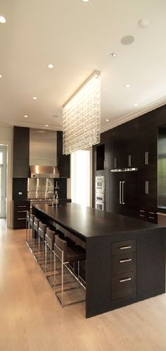 Modern Chic Kitchen..love the lighting fixuture above the Island!