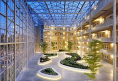Example of a typical atrium with large glazing areas on walls and roof and plantings on ground level Sustainable Architecture, Landscape Architecture, Interior Architecture, Landscape Design, Futuristic Architecture, Atrium Design, Roof Design, Lobby Design, Indoor Planters