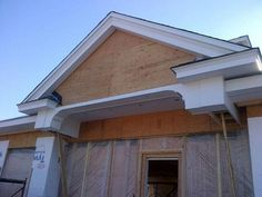 January 7th 2013 - In addition to the brick work, the construction crew is also working on the moldings around the doorways and windows. This is where our front door will eventually be.