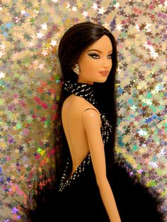 She is a 2006 Diwali Barbie head on a model muse body, no repaint, aOOAK dress by ebayer jnenno. Hope this helps.