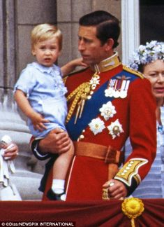 Prince Charles holding Prince William as a 2 year old at Trooping the Colour from Buckingham Palace. Today, Prince George, 23 months, wore this same outfit to his first Trooping the Color, 13 June
