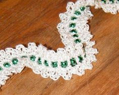 """Add this project to your Ravelry favorites HERE.  To print or convert to PDF click the green """"Print Friendly"""" button below the pattern.         Bead Garland designed by Kim Guzman © Apr. 2009 Email to kim@crochetkim.com Please read my Terms of Use  Technique:"""