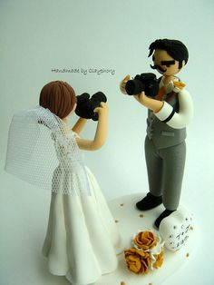 Lovely photographer couple customized cake topper. $150.00, via Etsy.