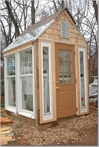 Garden greenhouse from recycled salvaged doors and windows. Building a greenhouse out of old windows by kellyfg- Greenhouses & Garden Structures Forum - link  goes to  GardenWeb