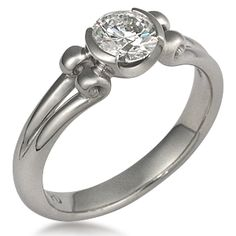 Carved Curls Light Engagement Ring - Inspired by the award winning Carved Curls design, this ring is made with a modest number of curls and is every bit as enchanting as its predecessor. 3mm wide.
