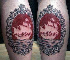 Negative space ship tattoo.