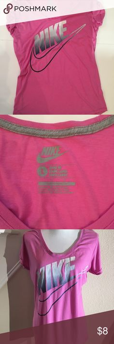 Nike T-shirt women's size L Cute Nike T in size L. Slightly longer length. Sleeves are sewn to be cuffed. This Tshirt shows a little wear. Some stitches are loose at the hem. See last pic. Still very cute for workouts or a sleep shirt! Nike Tops Tees - Short Sleeve