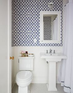 Penny tile floors in powder room?//Pattern bursts forth in a powder room covered in Vivienne Westwood for Cole & Son wallpaper. Powder Room Small, Powder Room Decor, Bathroom Wallpaper, Bathroom Makeover, Tiny Bathrooms, Downstairs Bathroom, Bathroom Design, Bathroom Decor, Blue And White Wallpaper
