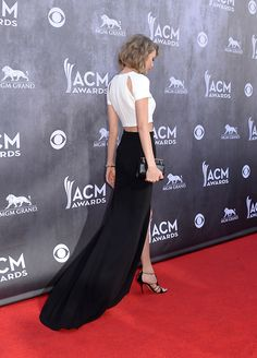 Taylor in a J. Mendel outfit with Casadei pumps and Marina B and Jennifer Fisher jewels at the 2014 ACM Awards.