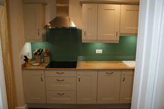 Quinag Matt Ivory Kitchen with Arlington Oak Laminate worktop and Olive Green Glass by Saffron Interiors - www.saffroninteriors.com / sales@saffroninteriors.co.uk / 01483 511068. #ivory #kitchen #oak #laminate #worktop #glass #olive #green #neff #blanco
