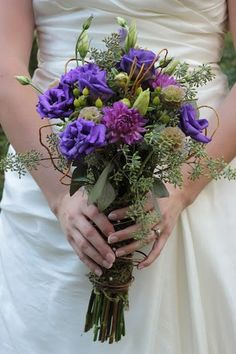 LOOKS LIKE THE BOUQUET IS WRAPPED IN IVY INSTEAD OF RIBBON!!!  GREAT IDEA!!!  Green and purple wedding