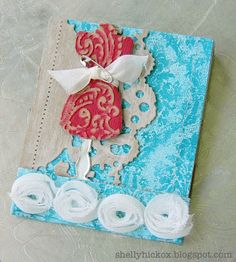 Mini sewing kit made using the Sizzix Matchbook die and Claudine Hellmuth's Sticky Back Canvas..