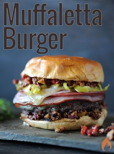 The Big Easy Muffaletta Burger, inspired by the signature New Orleans sandwich, is loaded with deli meats, cheese and olive spread.6 burgers2 pounds ground beef (80% fat/20% lean) 2 teaspoons dried oregano, divided 1 teaspoon kosher salt 1 teaspoon garlic powder 1/2 teaspoon black pepper 1/2 cup olive oil 1/3 cup red wine vinegar 3/4 cup garlic stuffed green olives 3/4 pitted