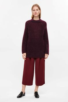 Made from a mohair-wool blend, this loose-knit jumper has wide, raglan sleeves. An oversized fit and style, it is completed with a tightly knitted high-neck and minimal, clean-cut finishes.