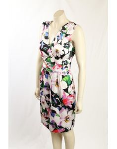 The dress is empire line in style and fully lined. It is perfect for summer events. Satin Cocktail Dress, Summer Events, Premium Brands, Designer Dresses, Size 14, Empire, Calvin Klein, Floral Prints, Ralph Lauren
