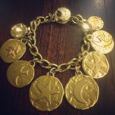 Be charmed with this beautiful vintage Yves Saint Laurent bohemian style charm bracelet. This gold toned treasure from the 1970s is an exquisite piece with eight dangling gold medallions and can be paired with everything from boho chic to a simple night out. We can tell its been someone's favorite as it shows slight signs of wear, which is a part of its vintage charm.   Price: Rs 14,200