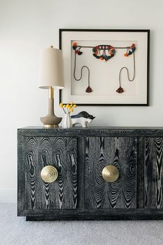 Media console and framed art. Love the texture in the console!