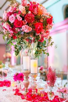 Hot Pink Rose & Dahlia Centerpiece    Photography: Ryan Phillips Photography   Read More:  http://www.insideweddings.com/weddings/romantic-30th-wedding-anniversary-vow-renewal-with-pink-palette/800/