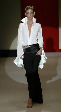 White shirt with long ruffled sleeves! | Inspiration only. No product link.