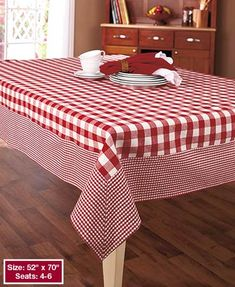 This check tablecloth adds quaint country style to your dining room or breakfast nook while offering durability for everyday use. The top has a large checkered pattern with a small checkered border. Easy care cotton. Machine care. Imported