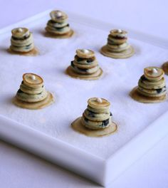Miniature short stacks. What's more comforting during a blizzard than a warm stack of pancakes?
