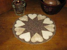 Wool heart candle mat....