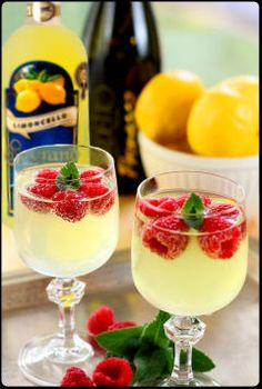 Limoncello and Prosecco cooler with raspberries More