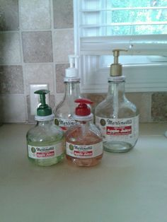 Reused glass bottles for soap dispensers