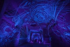 Stellar Caves: Immersive Tunnels of UV-Illuminated Thread Drawings by Julien Salaud