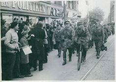 The Wehrmacht is leaving Denmark after they surrendered to the British troops, 6-5-1945. The public is cheering at the British troops about to pass