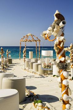 A shell-embellished altar and aisle raked in the sand will make a statement at any beach wedding.