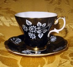 ROYAL ALBERT TEA CUP & SAUCER WHITE FLOWERS on BLACK BACKGROUND