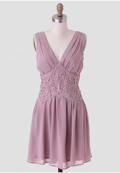 <p>Elegant and whimsical, this dusty mauve-hued dress is adorned with a sheer lace overlay around the waist and pleat details for a flowy feel. Designed with a flattering V-cut neckline and back and an exposed back zipper closure, this lovely dress can be styled with a faux fur capelet and T-strap heels for an upscale occasion. Fully lined.</p><p>100% Polyester<br /> Imported<br /> 30