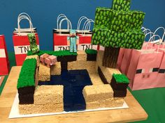 Minecraft cake: Jello water, rice krispie sand blocks and cake dirt blocks.  Paper cut out toppers purchased online.