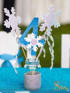 Sparkly snowflake centerpiece at a Frozen birthday party! See more party ideas at CatchMyParty.com!