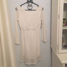 Lace ivory dress Lace ivory dress. Size small. Never been worn. Still has tags. Runs a little big. Sweet claire Dresses