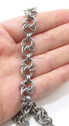 Celtic Spiral Knot Chainmaille bracelet in Stainless steel. Lobster clasp closure and extension chain