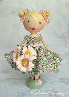 Green floral clothespin doll
