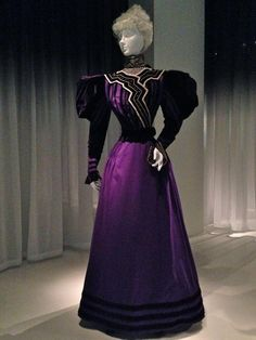 This purple half-mourning dress from James McCreery & Co. (New York department store, 1867-1954) from 1894-96 features full gigot sleeves that defined fashion in the mid-1890s.  Metropolitan Museum of Art in NYC.