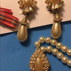 Vtg: Set of pearl earrings and necklace  . A unique design of jewelry made of faux pearls and crystal like stones assemble in gold tone metal base. New w/o tag. Jewelry Necklaces