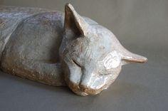 Japanese sleeping cat ceramic sculpture