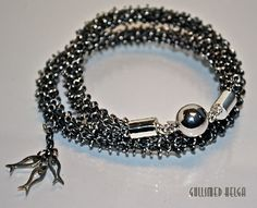 Silverknitted necklace by Helga Markhus
