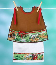 Faux Leather Fairy Tale Sleeveless Bibock with Lapkin. Size large (2-5 years of age) This handsome sleeveless Bibock with Lapkin features the softest, touchable, slightly textured, warm honey brown faux leather. It is scrumptious to the touch and has been a real source of calming influence to those who have high sensory issues or other special needs. It is animal friendly. The cotton fairy tale print highlights the story classics The Three Bears, Hansel and Gretel, The Three Pigs, Little Red…