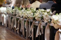 church flowers...if only I could afford that many but maybe on a few pews would be ok.