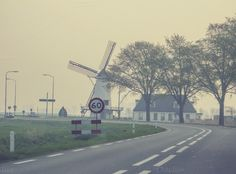 Check out Windmill near winding road by Patricia Hofmeester on Creative Market