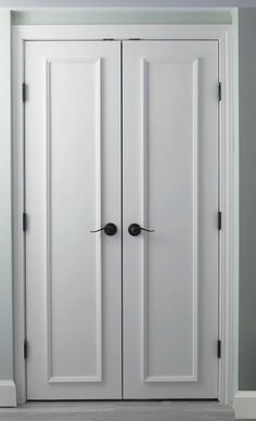 Slab doors with applied moulding. Gorgeous closet doors!
