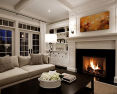 Love everything in this room. Great mantel design!