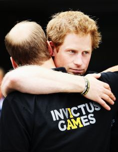 The Duke of Cambridge hugs his brother, Prince Harry, as he leaves during the Invictus Games athletics. September 11, 2014...Tumblr