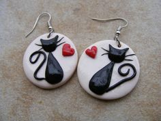Hey, I found this really awesome Etsy listing at http://www.etsy.com/listing/127468206/black-cats-in-love-polymer-clay-earrings